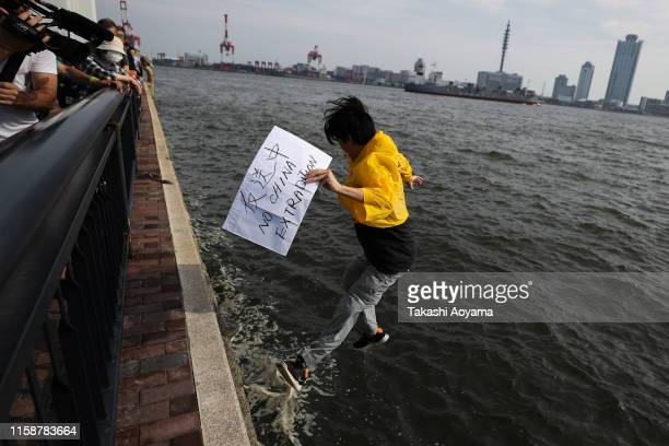 Man from Hong Kong jumps in the Sea during a protest on June 28, 2019 in Osaka, Japan. U.S. President Donald Trump arrived in Osaka on Thursday for...