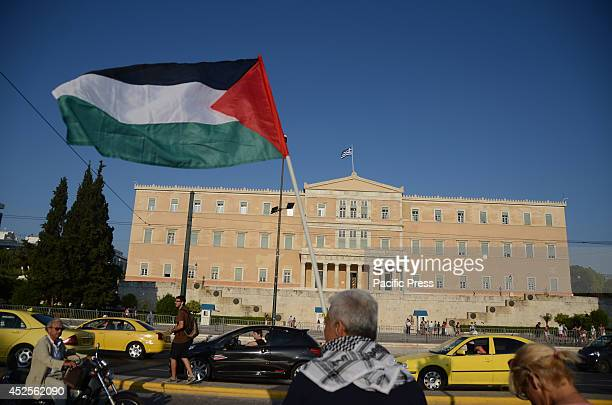 Man from Palestine waves a Palestinian flag in front of the Greek parliament. Palestinians that live in Greece together with supporters organized a...