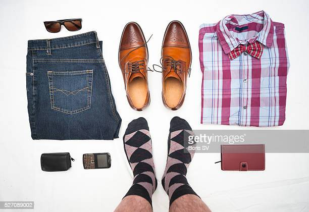 Man from personal point of view knolling his wardrobe with vivid colors.