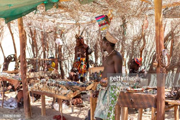 a man from the himba tribe, namibia selling hand made crafts - mottled skin stock pictures, royalty-free photos & images