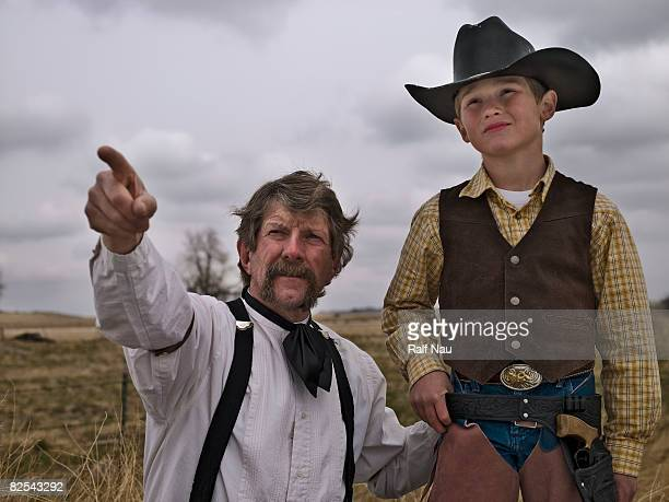 Man from the past teaching young cowboy a lesson