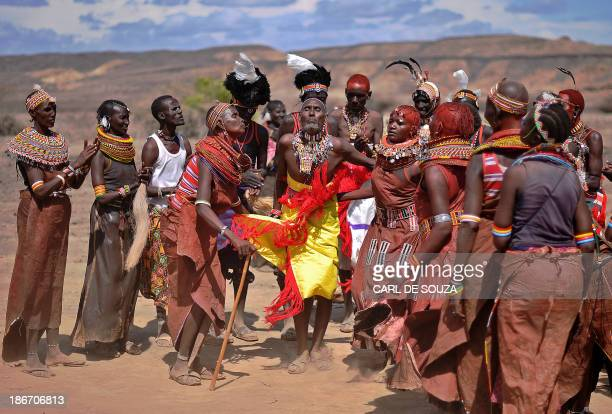 A man from the Rendile tribe dances with women from the Turkana tribe before total hybrid eclipse in Sibiloi national Park in Turkana on November 3...