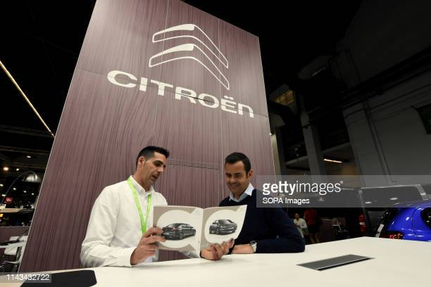 A man from the staff of the French car brand Citroën informs a customer about the new vehicles in the Automobile Trade Fair 2019 in Barcelona