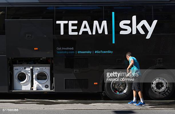TOPSHOT A man from the Team Sky staff cleans the bus of team on the second rest day of the 2016 Tour de France cycling race in Hilterfingen on July...