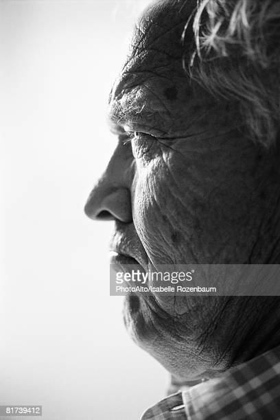 Man frowning, profile, portrait