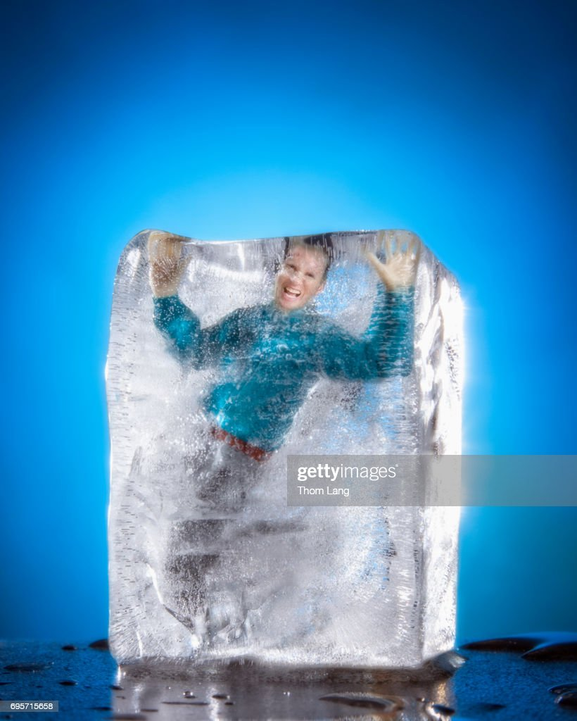 man frozen in block of ice foto de stock getty images