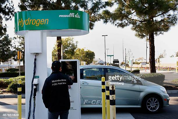 A man fuels a Daimler AG MercedesBenz FCell vehicle at a public hydrogen pumping station outside the Orange County Sanitation District wastetreatment...