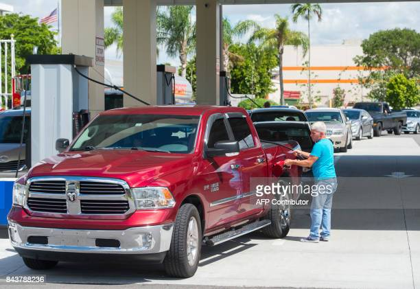 A man fuels up his car with gas at a Costco Gas Station as they prepare for Hurricane Irma in Miami Florida September 7 2017 Miami orders people...
