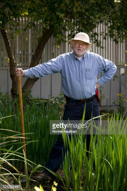 man gardening - get your hoe ready stock pictures, royalty-free photos & images