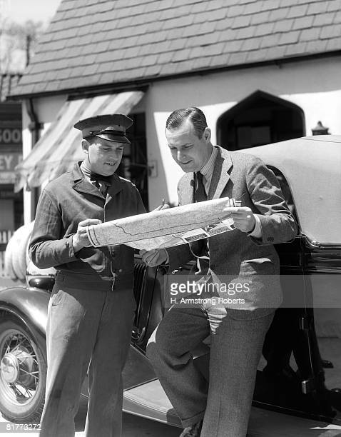 Man Gas Station Attendant And Motorist Reading Map Directions Help Service Assistance.