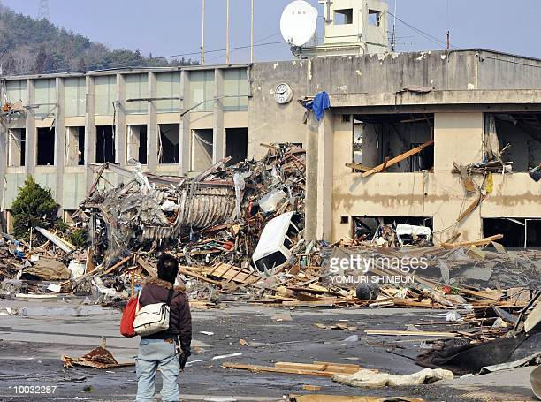 A man gazes at a wall clock which indicated the time that the tsunami hit Otsuchi town in Iwate prefecture on March 13 2011 Japan battled a feared...