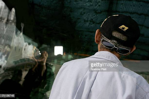 A man gazes into a television studio in Times Square June 6 2006 in New York City According to the Bible's Book of Revelation 666 is the mark of the...