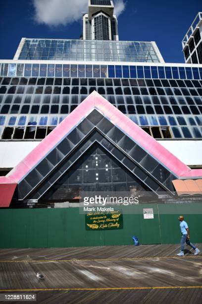 Man gazes upwards towards the ongoing demolition of Trump Plaza Hotel and Casino, once one of the city's premier destinations, on September 30, 2020...
