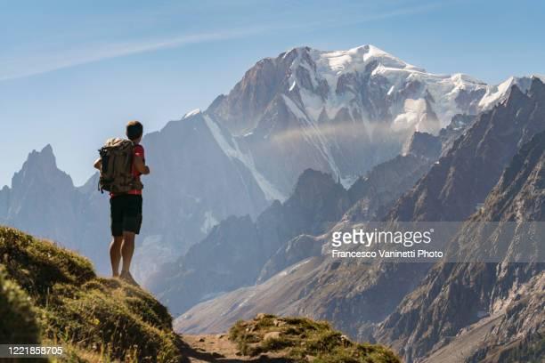 man gazing at mont blanc, italy. - クールマイヨール ストックフォトと画像