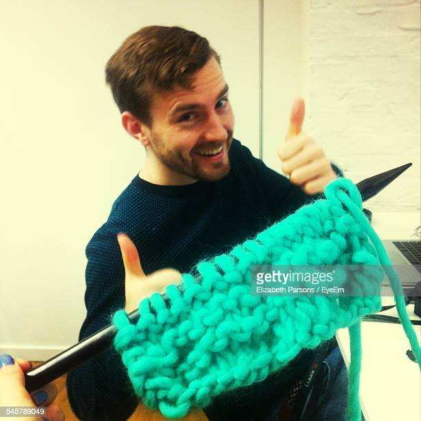 Man Gesture Thumbs Up With Knitted Wool In Foreground