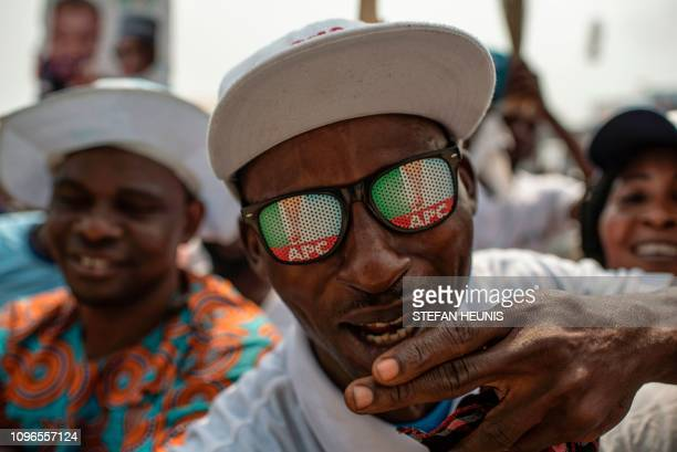 A man gestures before the All Progressive Congress party campaign rally held by Nigerian President at Teslim Balogun Stadium in Lagos on February 9...