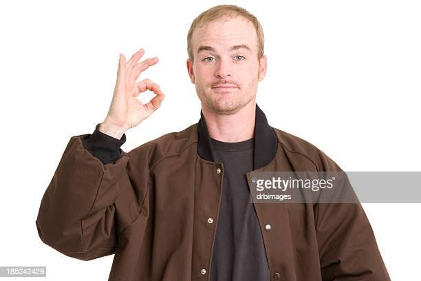 Man Gestures Okay Sign