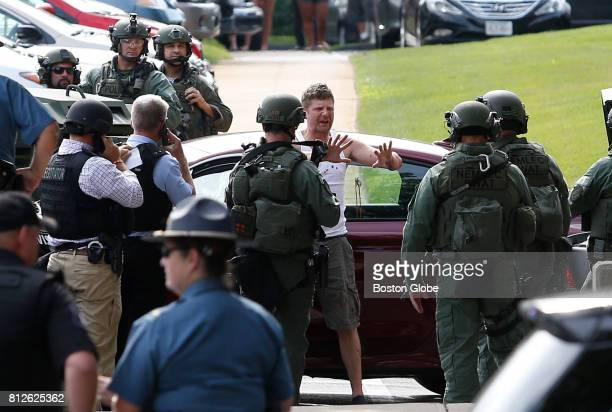 A man gestures to SWAT team members after stepping from his car outside of a building on Cabot Street after a standoff in Medford MA on Jul 10 2017...