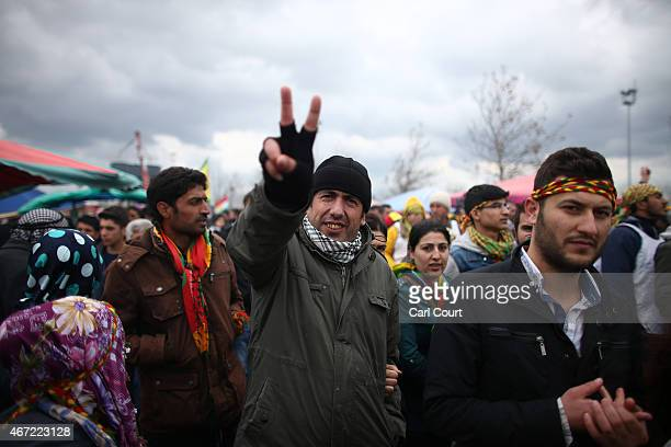 Man gestures with a victory sign as Kurds from Turkey and Syria celebrate Kurdish New Year on March 21, 2015 in Diyarbakir, Turkey. Diyarbakir has...