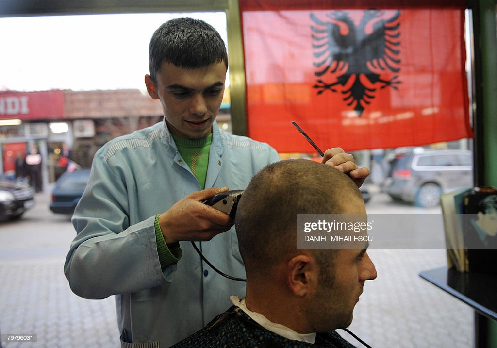 A Man Gets A Hair Cut At A Barber Shop D Pictures Getty Images