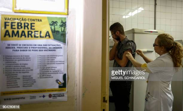 A man gets a vaccine against yellow fever at an outpatient clinic in Sao Paulo Brazil on January 12 2018 Brazil stepped up prevention measures...