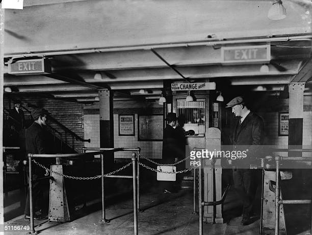 A man gets change in nickels from a change booth operator so he can pass through the new nickeloperated turnstiles which have replaced the ticket and...