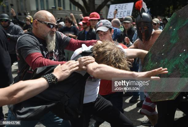 A man gets hit as multiple fights break out between Trump supporters and antiTrump protesters in Berkeley California on April 15 2017 Hundreds of...