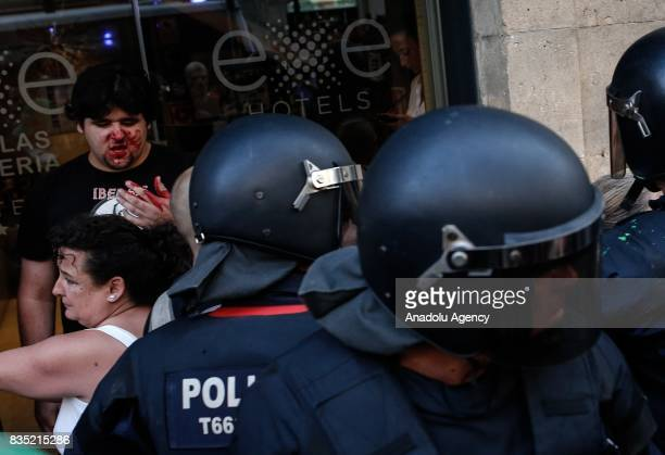 A man gets injured as representatives of Catalan organizations and people clash with a group of protesters who stage an anti Islamic protest at La...