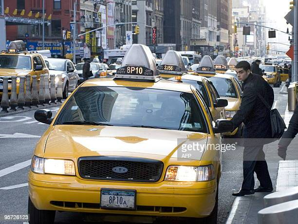 A man gets into a cab outside the Port Authority Bus Terminal January 12 2010 in New York There are about 13000 Medallion taxis in New York City AFP...