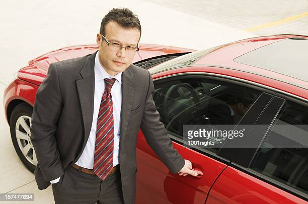Man gets into his red car