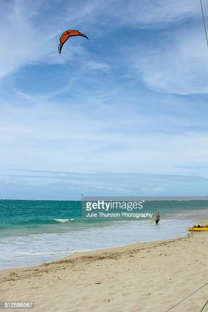 Man Gets Ready on the Shore to Head Out into the Water to Enjoy Some Kiteboarding at the Vacation Travel Destination Kailua Beach Hawaii on the...