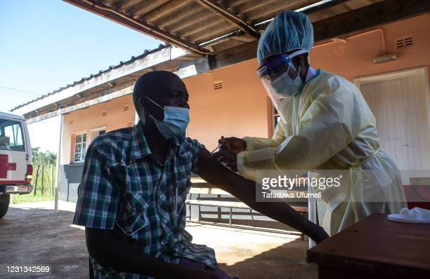 Man gets the Sinopharm vaccination at Chivhere Village Clinic in Zvimba Rural District on February 23, 2021 near Chinhoyi, Zimbabwe. The country is...