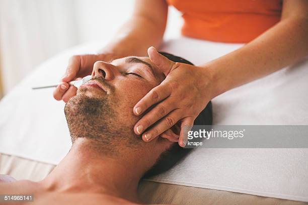 Man getting a face treament at the health spa