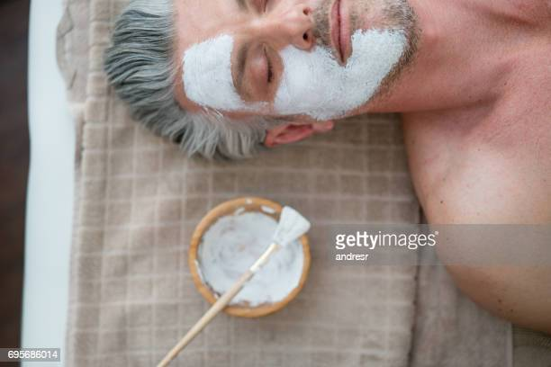 Man getting a facemask at the spa