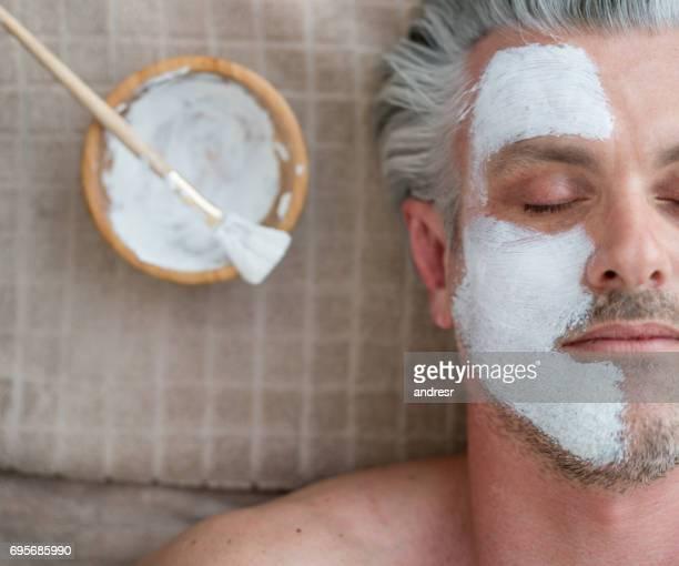 Man getting a facial at the spa