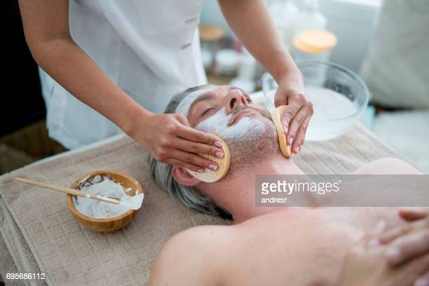man getting a facial at the spa - metrosexual stock pictures, royalty-free photos & images