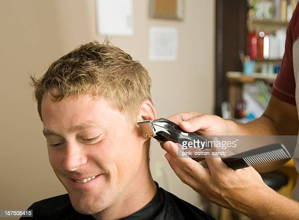 A man getting a haircut at a salon