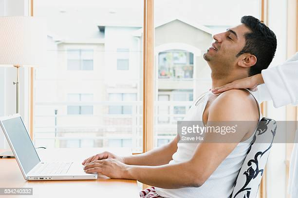 man getting a shoulder rub - husband massage wife stock photos and pictures