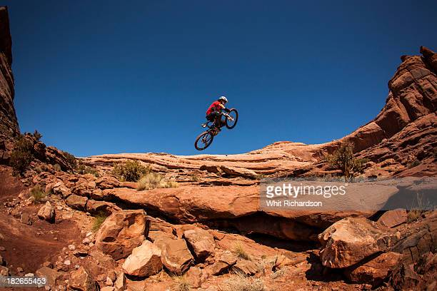 A man getting air on a jump on his montain bike near Moab, Utah.