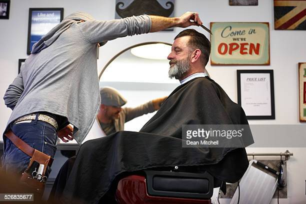 Man getting an haircut from hairstylist