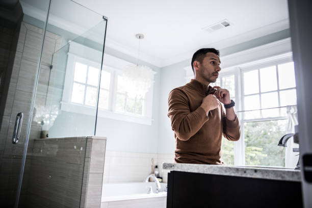 man getting dressed for work at home - preparation stock pictures, royalty-free photos & images