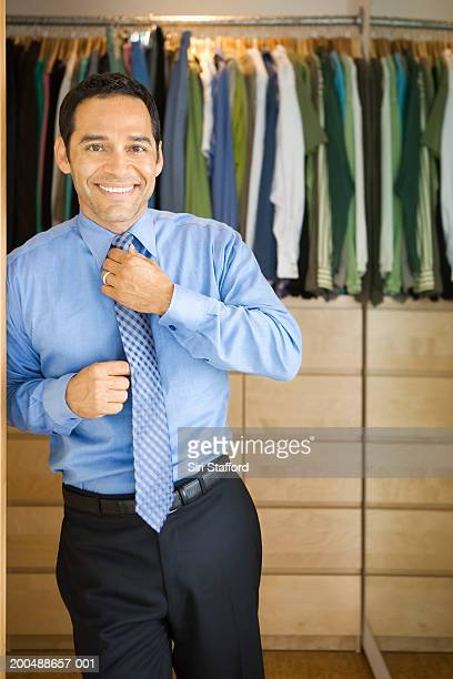 man getting dressed for work - walk in closet stock photos and pictures