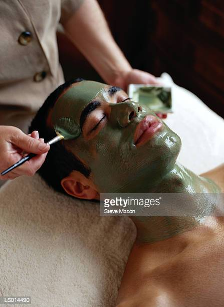Man getting facial, elevated view, close-up