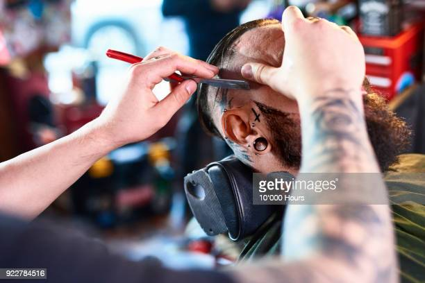 man getting haircut in barber shop - razor stock photos and pictures
