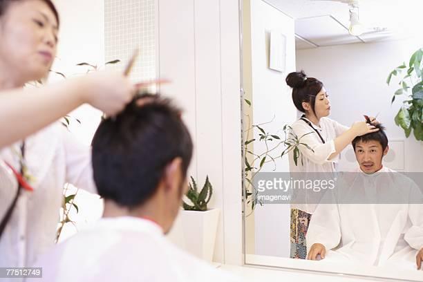Man Getting Haircut in Salon