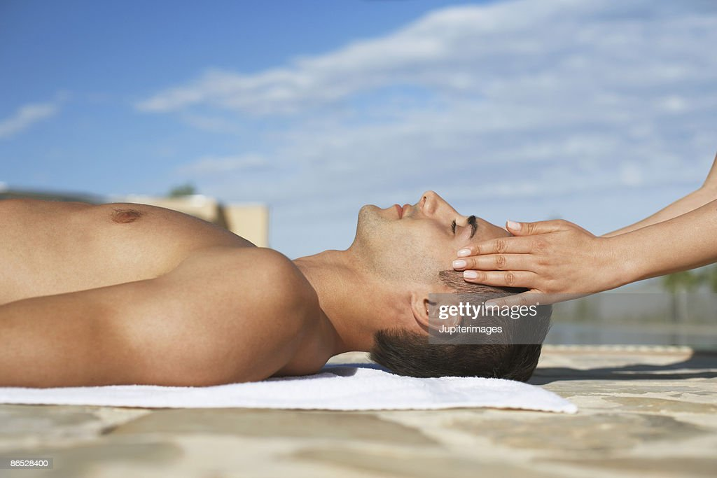 Man getting head massage : Stock Photo