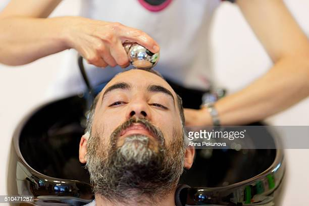 Man getting his hair washed in hairdresser salon