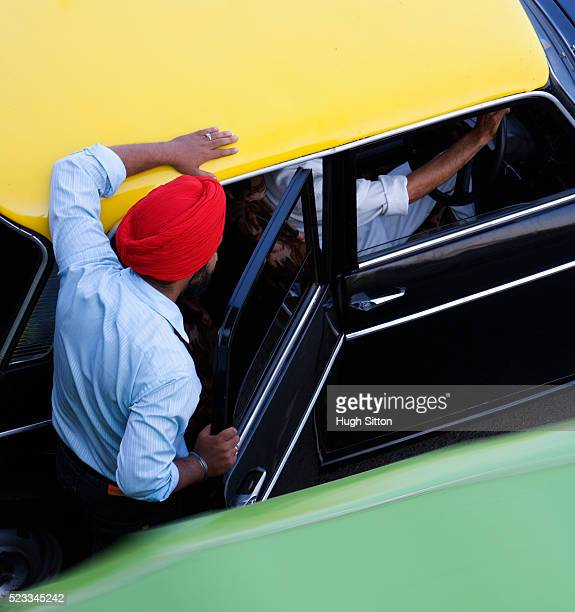 man getting into taxi - hugh sitton stock pictures, royalty-free photos & images