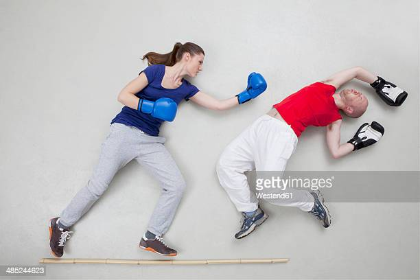man getting knocked out in boxing fight - domination stock pictures, royalty-free photos & images