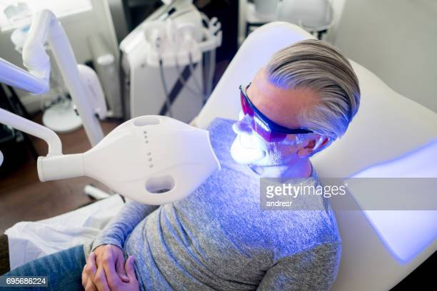 Man getting laser teeth whitening